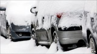 Cars covered in snow near Ashford in Kent
