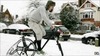 Man riding a snowbike in Weybridge