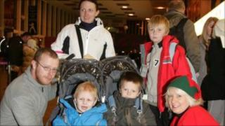 The Stevens family from Kilsyth with Prestwick Airport elf Gail Gemmell.