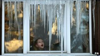 Icicles on house window