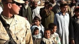 US marine (left) with Afghan schoolchildren, Marjah