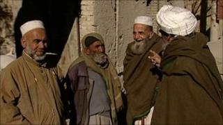 Afghan men talking in the street
