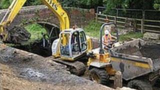 Digger on the Stroudwater Canal