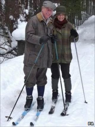 The Prince of Wales and Duchess of Cornwall cross-country skiing in Scotland