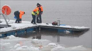 Volunteers at Foyle Search and Rescue trying to save the pontoon from the ice