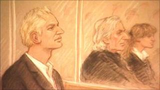 Julian Assange (left) in court