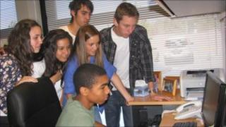 Uruguayan students check the stock market on their classroom computer