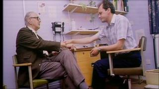 Dr in GP surgery talking to a patient