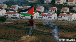 Palestinian protester opposite Jewish settlement of Halamish in the West Bank. Oct 2010