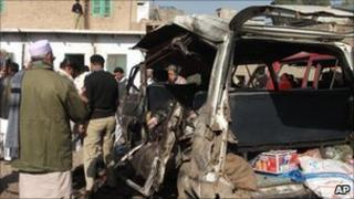 People gather at the scene of the blast in Kohat