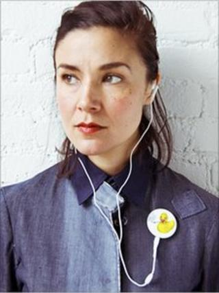 Woman wearing and listening to a Playbutton album (Pic: Playbutton)