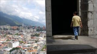 Person walks high in the Confinanza Tower in Caracas