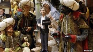 A statuette of Julian Assange in the creche