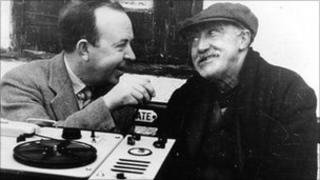 Calum Maclean (left) records some folklore with a man in the 1950s