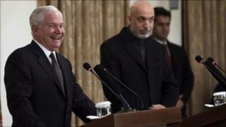 Robert Gates (L) with Hamid Karzai at a news conference in Kabul on 8 December 2010