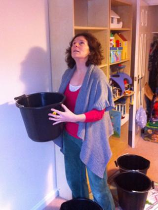 Nina MacLeod catching drips in her bucket