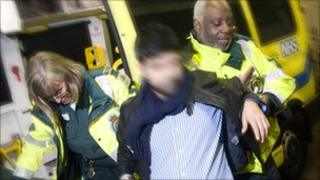 A man is treated by London Ambulance staff