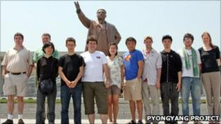 Students standing in front of a statue of Kim Il-sung in Pyongyang