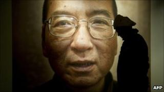 A man passes a poster of jailed Chinese dissident Liu Xiaobo in Oslo, 9 December