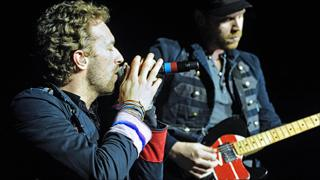 Coldplay's Chris Martin and Jonny Buckland (r)