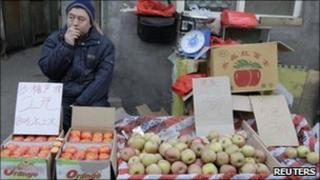Stallholder in Beijing, file pic