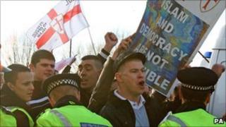Members of the English Defence League demonstrate during a march through the centre of Peterborough, Cambridgeshire, on Saturday 11 December