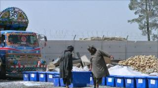 Election workers load ballot boxes onto a truck to be distributed to polling stations in Kandahar on September 16, 2010
