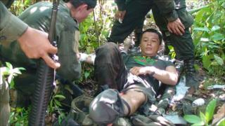 Rubiel Rodriguez being treated by his colleagues after stepping on a landmine on 2 May 2009