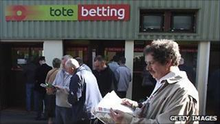 Racegoers outside a Tote betting window