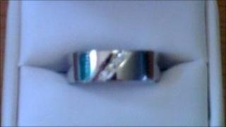 One of the custom-made wedding rings that were stolen