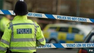 Police officer at crime scene (generic)