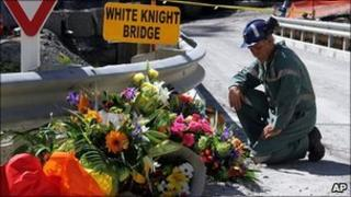 A miner lays down flowers at White Knight Bridge near the entrance to the Pike River mine where 29 miners died, in Greymouth (file image from December 2010)