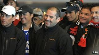 Chilean miner Mario Sepulveda (centre) reacts with fellow miners