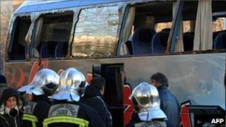 Croatian firefighters and others survey the damaged coach, 14 December