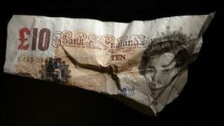 A crumbled £10 note