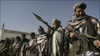 Former Taliban fighters surrender weapons in Herat, Dec 2010