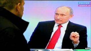 Russian Prime Minister Vladimir Putin speaks in a televised discussion with an audience on 16 December 2010