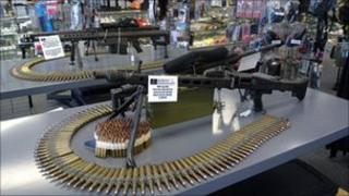 An automatic gun sitting on a table at a store