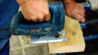 Worker using a jigsaw saw