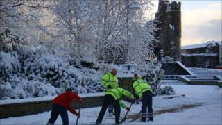 Workmen clearing Castle Square in Swansea