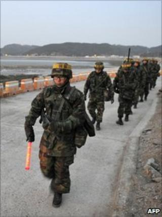 South Korean marines patrol on Yeonpyeong island (18 Dec 2010)