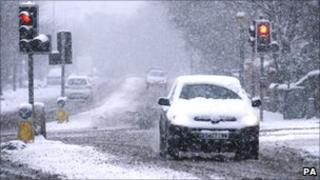 A car in Edinburgh as snow and icy conditions hit central Scotland
