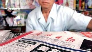 A newsstand vendor in China