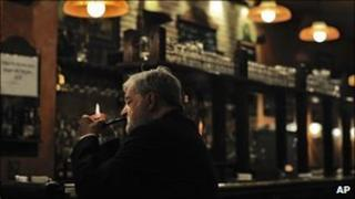 A man smokes in a bar in Pamplona, Spain, 21 December 2010