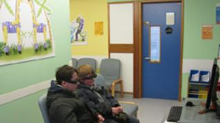 Young patients watching zoo film with 3D glasses