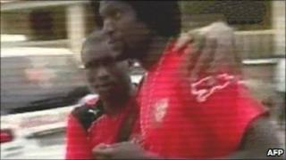 TV grab of Emmanuel Adebayor following the shooting which killed members of the Togolese football team in Cabinda, January 2010.