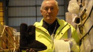 UK Border Agency officer Glen Dickins with fake Ugg boot