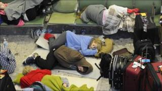 Passengers sleep on makeshift beds in Terminal 3 at Heathrow Airport