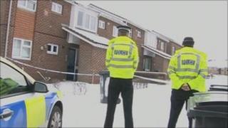 Police guard flats at Calshot Walk