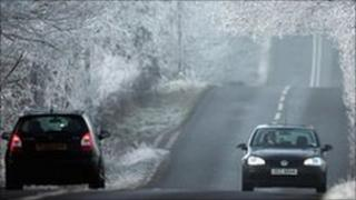 Motorists driving in snowy conditions